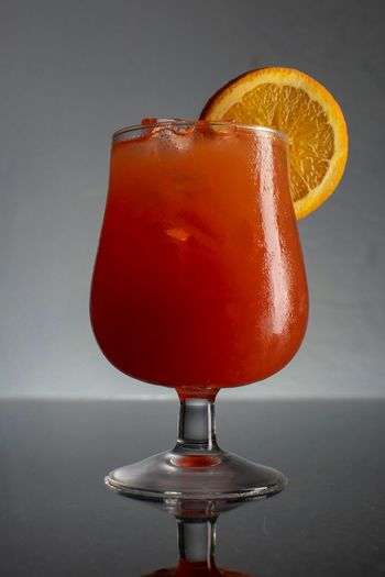 Hurricane Drinks Orange Capitan Morgan Southern Comfort Hurricane Drink Citrus Fruit Fruit Food And Drink Glass Drinking Glass Food Drink Cocktail Freshness Refreshment Close-up Indoors  Alcohol SLICE Studio Shot Table Orange Color Glass - Material No People