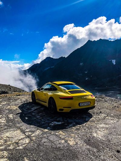 911t Porsche Cloud - Sky Mode Of Transportation Car Sky Motor Vehicle Nature Yellow No People Day Mountain Outdoors Travel First Eyeem Photo
