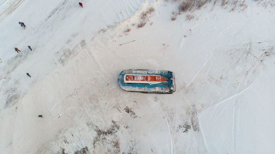 High angle view of text on snow covered land