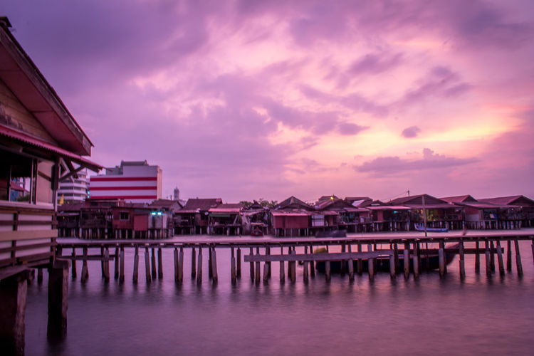 Dawn hours in a fishing village. Architecture Bay Beauty In Nature Building Building Exterior Built Structure Cloud - Sky Dusk House Nature No People Outdoors Purple Reflection Residential District Scenics - Nature Sea Sky Stilt House Sunset Water Waterfront TOWNSCAPE Romantic Sky Dramatic Sky Scenics Rooftop Moody Sky Atmospheric Mood Groyne