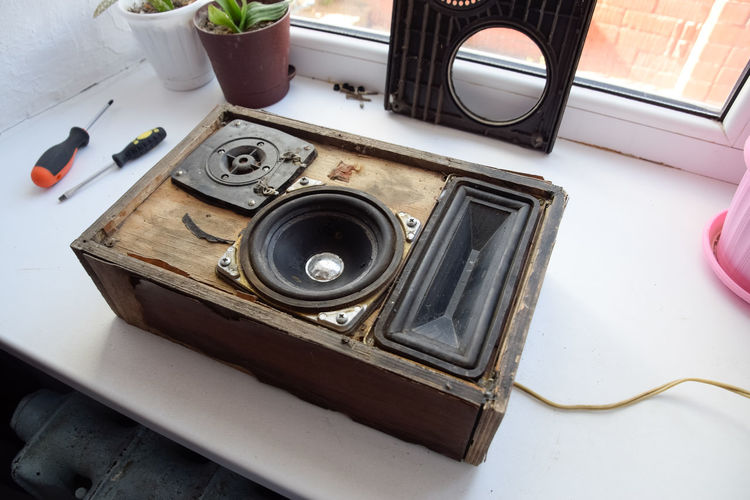 High angle view of old speaker on table