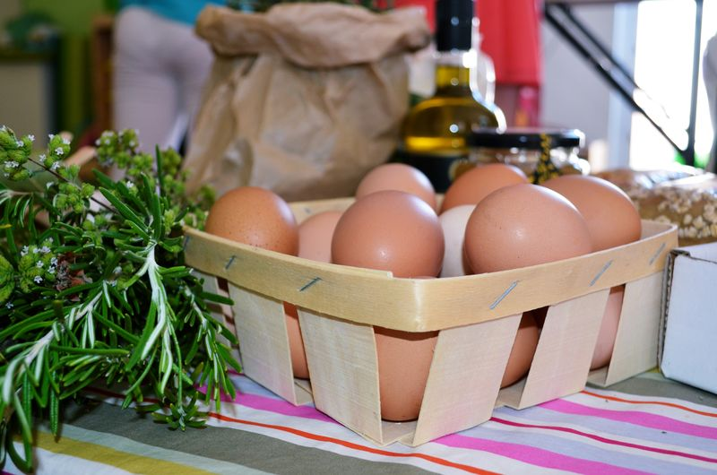 Close-up of eggs in basket on table