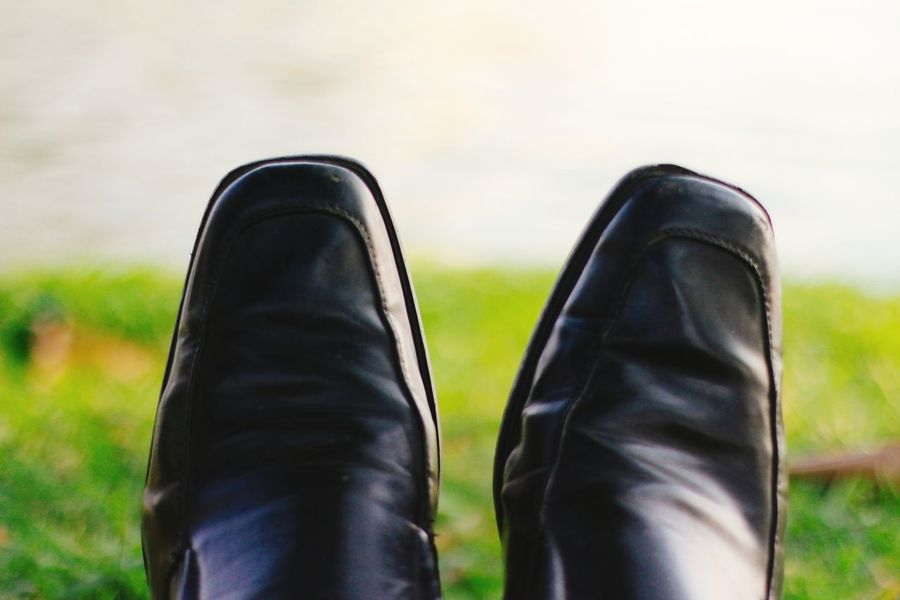 Shoe Black Color Low Section Human Foot Human Body Part Human Leg Pair Grass Dress Shoe Standing Close-up Lifestyles Day People Adult Outdoors Only Men Focus On Foreground Green Color Sky Field One Person Nature