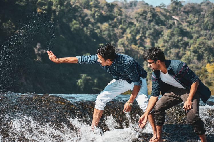 People enjoying in water splashing