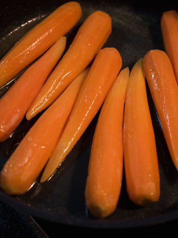Butter and sugar glazed peeled carrots in black pan Cooking Orange Butterfly Butterfly - Insect Carrot Close-up Food Food And Drink Glezed Karotten Kitchen Möhren No People Orange Color Pan Preparing Food Still Life Suga Vegetable