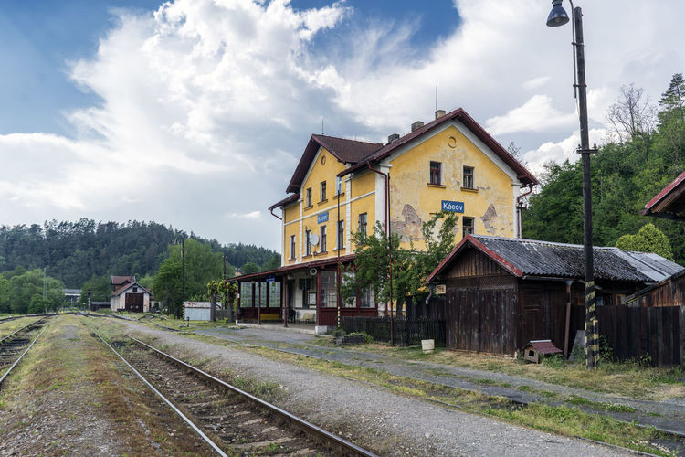 Old disused railway station in the village of Kacov, Czech Republic Abandoned Buildings Architecture Building Exterior Built Structure Cloud - Sky Czech Republic Day House Nature No People Outdoors Railroad Scenics Sky Station Train Train Transportation Tree
