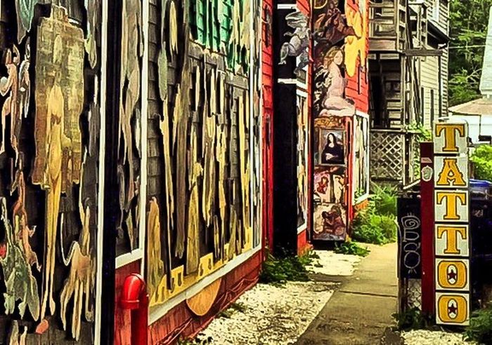 Art And Craft Arteverywhere Alleyway EyeEm Best Shots Streetphotography Streetart Tatoo Woodcarving Streetphoto_color Pathway Box Creativity Large Group Of Objects Colorful Multi Colored Outdoor Photography Building Exterior Architecture Nikon Commercial Street Artsy PTown Cape Cod Abundance EyeEm Best Edits