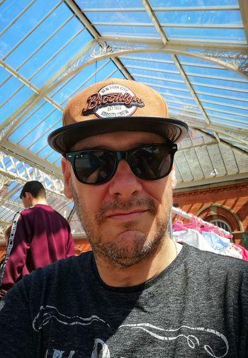 New cap Brooklyn Roof Glass Roof Sunglasses Portrait Looking At Camera Headshot Sunglasses Sky Posing Head And Shoulders Glasses Wearing