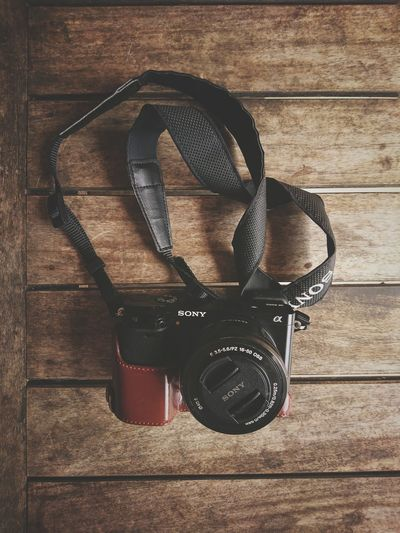 Sony A6000 One Thing One Thing I Can't Live Without Eyeem Philippines Digital Camera Sony Sony Alpha Gadget Hobbyistphotographer Hobbyists Wood - Material Table Directly Above Still Life Close-up