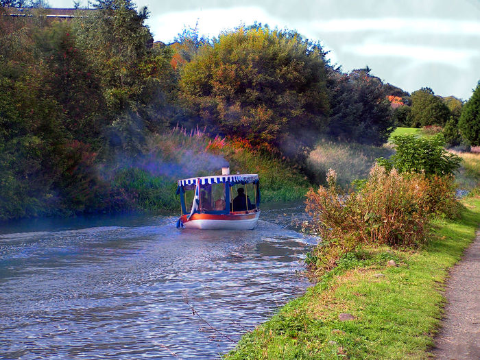 I took this picture at a mass meeting of barges and boats that sailed up the Union canal between Edinburgh and Ratho Village #steam Powered Barge #steam Powered Boat Beauty In Nature Day Nature No People Outdoors Sky Transportation Tree Water Water Transportation