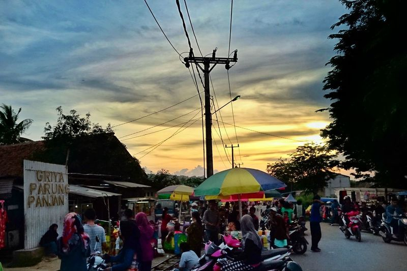 The market Arts Culture And Entertainment Large Group Of People Sky Silhouette Cloud - Sky Outdoors Leisure Activity Nature People Sunset Tree