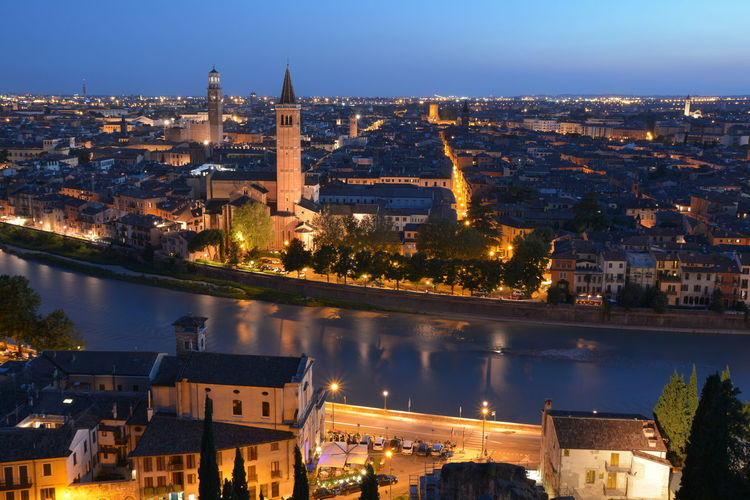 Verona at sunset, high angle view of illuminated buildings in city
