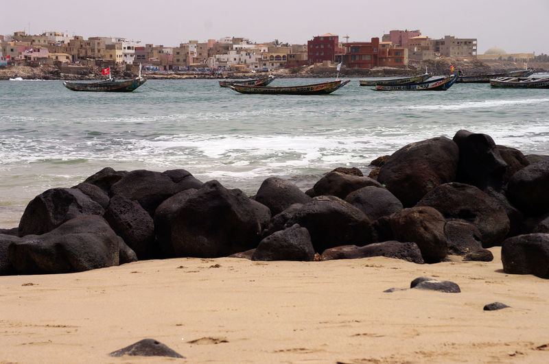 City Dakar N'gor Island Nature Ngor The Traveler - 2018 EyeEm Awards Transportation West Africa Africa Architecture Beach Beauty In Nature Boat Building Exterior Built Structure City Day Land Motion Nature No People Outdoors Pirogue Rock Rock - Object Rocks Sea Senegal Shore Sky Solid Tourism Travel Destinations Water Wave