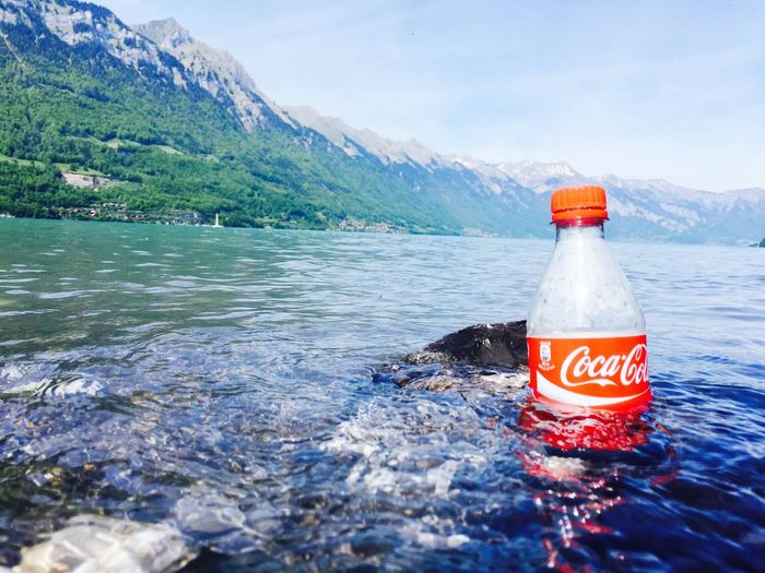 The most Natural Way to Cooldown my Cocacola in the Lake Thun Hot Summer Day Swiss Alps Snapshots Of Life Interlaken IPhoneography Softdrink Creative Cold Traveling Sunshine My Best Photo 2015