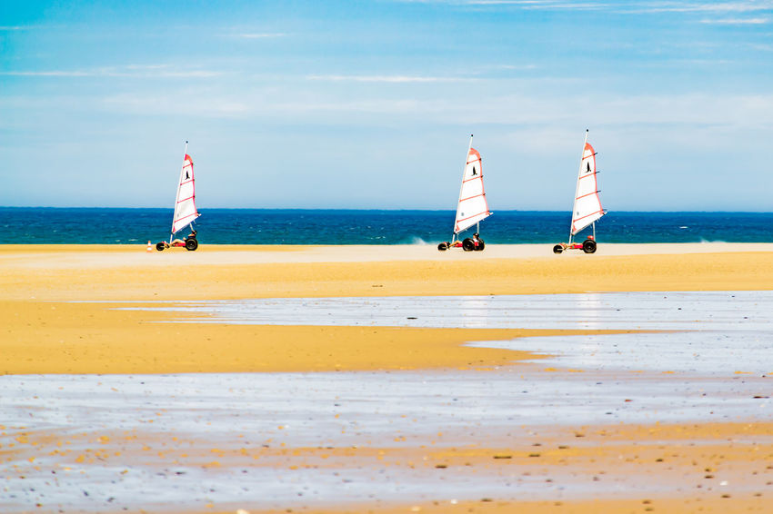 Beach surfers in Normandie Water Horizon Sky Scenics - Nature Land Beauty In Nature Nature Outdoors Day Normandie France Beach Wind Sand Blue Sky Windsurfing Beachsurfing Sandsurfing Watersports