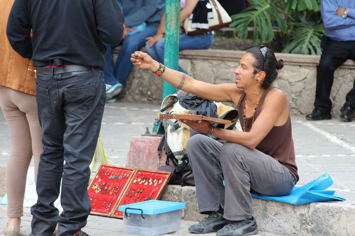 Ear Rings Hand Made Jewelry Occupation Real People Selling In The Street Sitting Young Adult