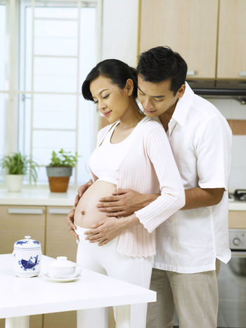 husband holding pregnant wife 9 Months Expecting Feeling Growth Love Married Stomach Day Time Development Fertile Fertility Future Holding Indoors  Kitchen Newlife Pregnancy Pregnant Responsibility Standing Taking Care Togetherness Two People Women
