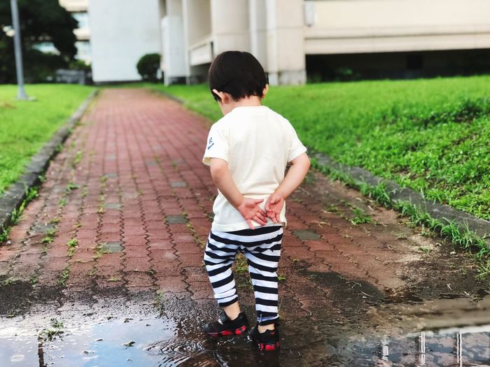 March a puddle Marching Puddle Child Childhood Full Length Casual Clothing Boys First Eyeem Photo EyeEmNewHere