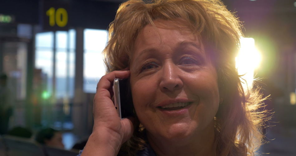 Portrait of smiling woman using smart phone