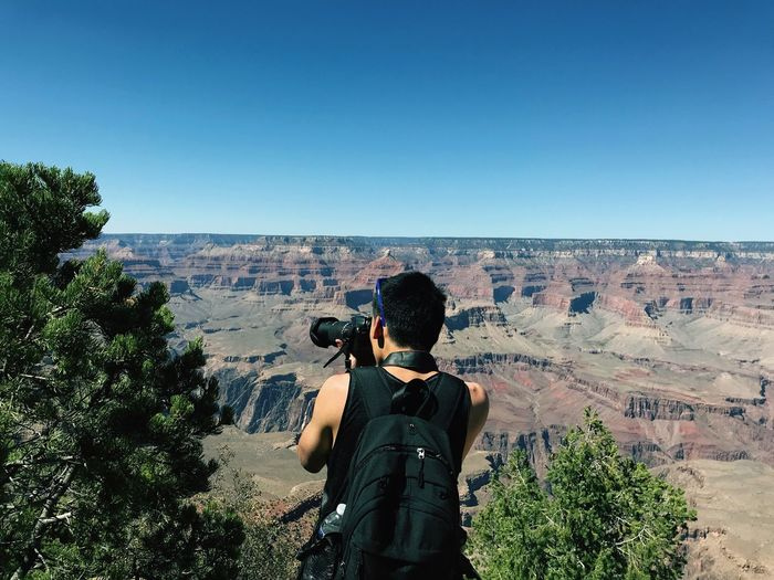 Canyon Outdoor Travel Nature Real People Rear View Lifestyles Nature Clear Sky Leisure Activity Scenics - Nature Photography Themes Plant Non-urban Scene