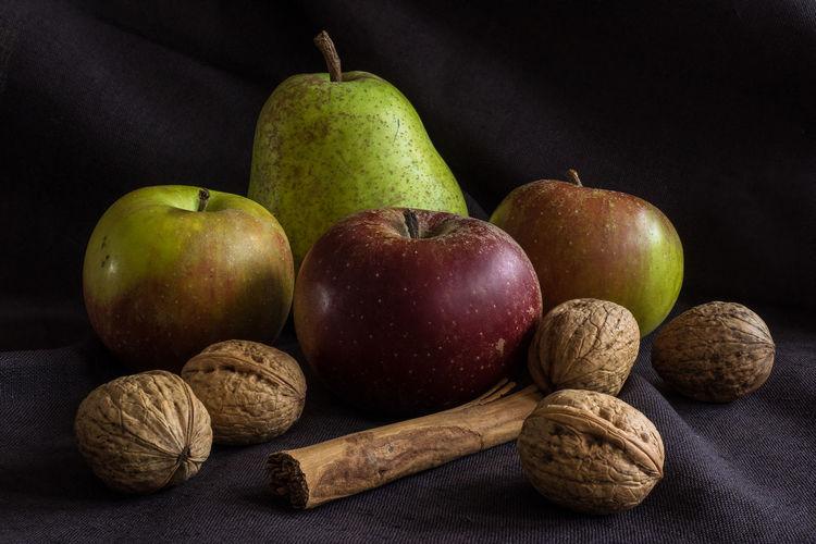 Apples Cinnamon Sticks Close-up Dark Food Fruit No People Pear Still Life Walnuts
