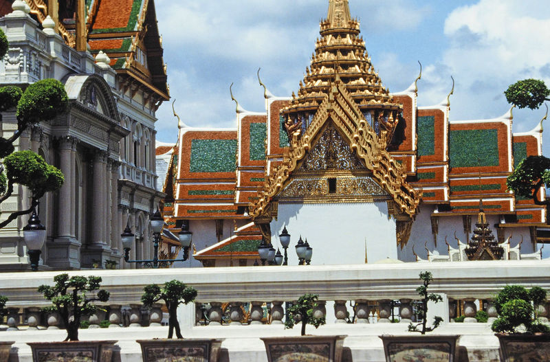 The Grand Palace - Bangkok, Thailand Architecture Sky Tree Spirituality Statue Day Outdoors Sculpture Religion No People Place Of Worship Grand Palace Bangkok Thailand Travel Destinations Cloud - Sky Building Exterior Built Structure Bangkok, Thailand. A Taste Of Thailand