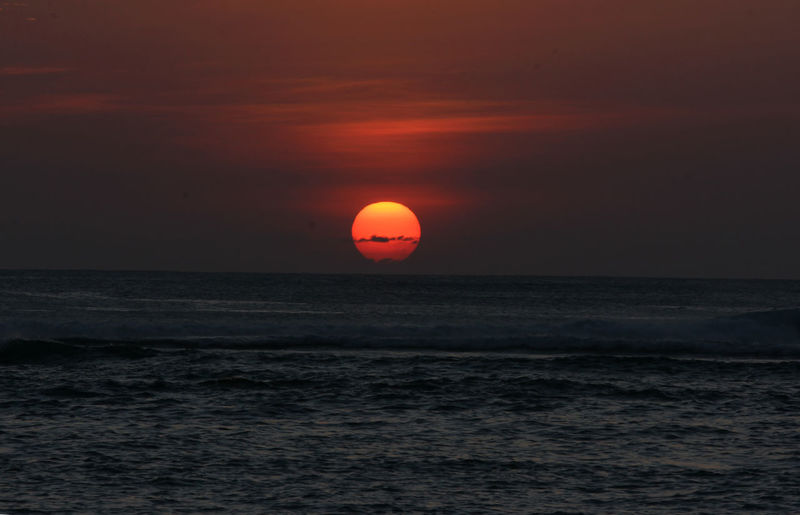 Sunset at Lhoknga beach, Aceh Province, Indonesia Sea Horizon Over Water Water Sky Scenics - Nature Sunset Horizon Beauty In Nature Sun Waterfront Orange Color Idyllic Tranquil Scene Tranquility Nature Non-urban Scene No People Outdoors Remote