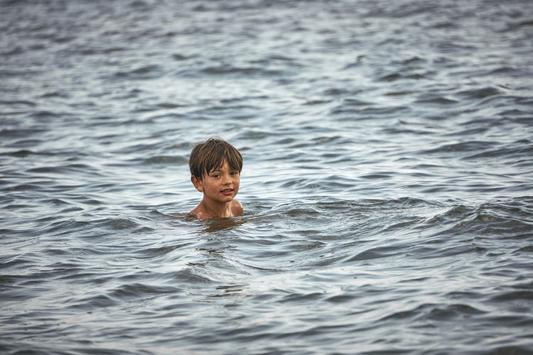 Stillness Calm Boy Boys Child Childhood Front View Headshot Innocence Leisure Activity Lifestyles Looking At Camera Men Nature One Person Outdoors Overcast Portrait Real People Sea Swimming Water Waterfront Wet Hair EyeEmNewHere