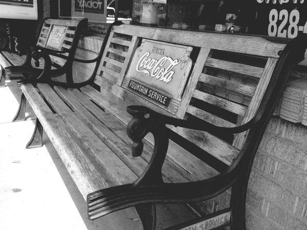 Black & White Coca Cola Bench Enjoying Life