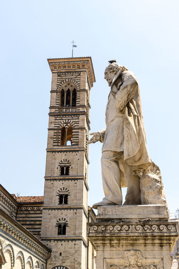Shot taken in the city of Prato, Italy Architecture Art And Craft Belief Building Building Exterior Built Structure Day Human Representation Low Angle View Male Likeness No People Outdoors Place Of Worship Religion Representation Sculpture Sky Spirituality Statue