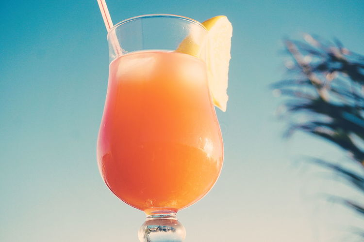 Tropical cocktail Alcohol Drink Orange Juice  Fresh Blue Sky Summer Summertime Alcohol Drink Cold Temperature Cocktail Drinking Glass Party - Social Event Orange Juice  Drinking Straw Ice Cube Close-up Tropical Drink Martini Glass Aperitif Tequila - Drink Cocktail Party