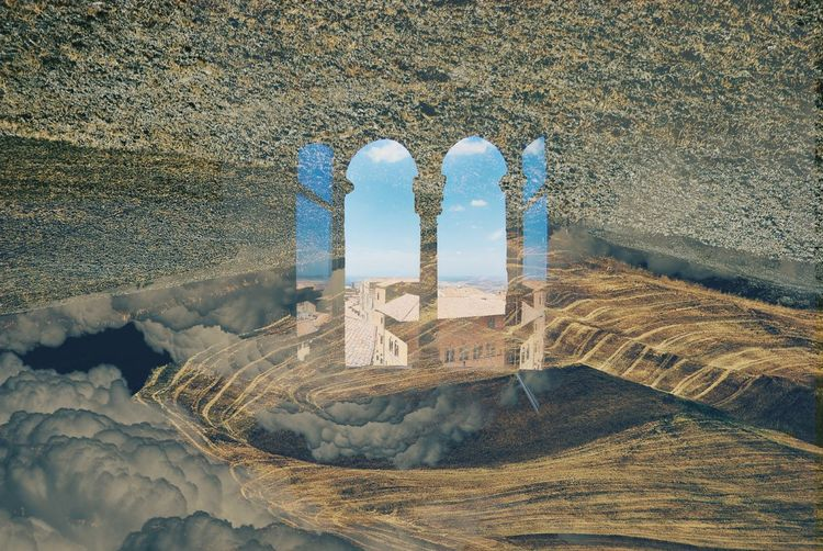 Double exposure of window view against tuscany land