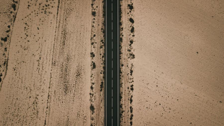 High angle view of railroad tracks on desert
