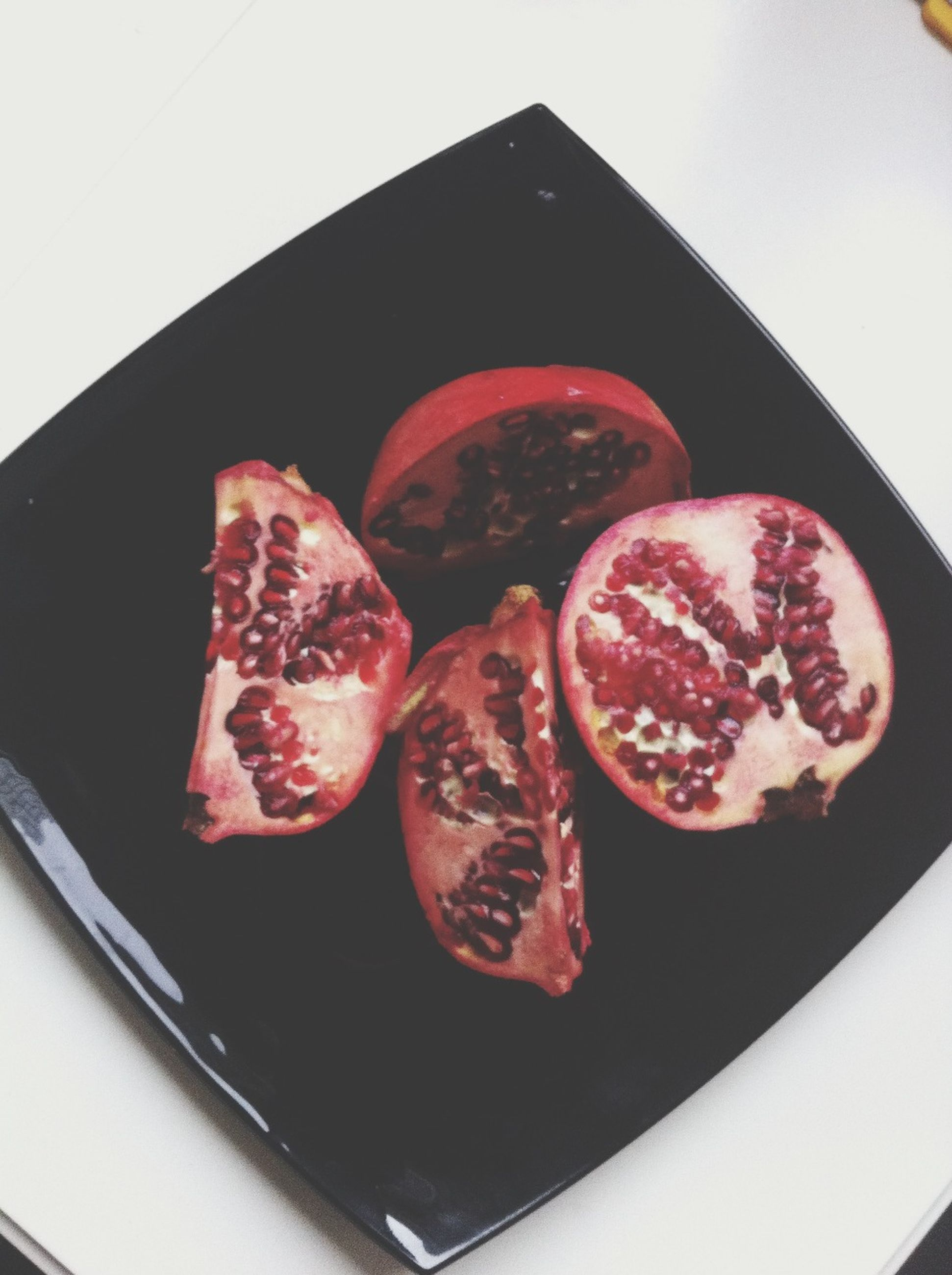 food and drink, food, freshness, indoors, sweet food, still life, ready-to-eat, dessert, indulgence, close-up, plate, temptation, red, unhealthy eating, strawberry, fruit, cake, high angle view, table