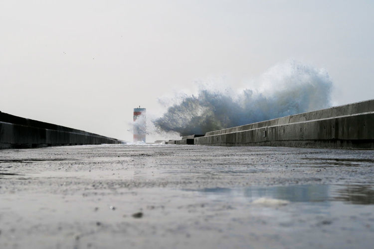 big wave of the atlantic ocean crushin over the walkway in the harbour of porto, portugal Wave White Storm Dangerous Tsunami Powerful Water Atlantic Ocean Porto Portugal Forces Of Nature Weather Febuary  Water Power In Nature Force Motion Spraying Breaking Beach Analogue Sound
