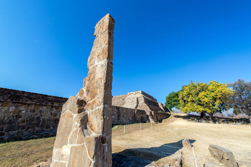 Stele and temple in the ruins of Monte Alban in Oaxaca, Mexico Architecture Hills Mayan Mayan Ruins Mexico Oaxaca Oaxaca México  Pyramid Rock Ruins Temples Travel Building Maya Monte Alban Mountain Old Platforms Rocks Ruin Stela Stone Stones Temple Tourism