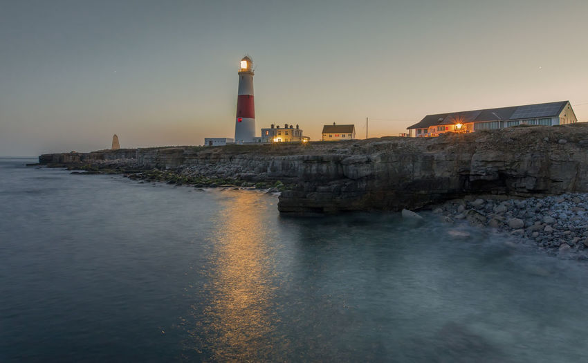 Portland Bill at dusk, Dorset Jurrasic Coast Portland Bill After Glow Architecture Building Building Exterior Built Structure Direction Dusk Guidance Illuminated Lighthouse Motion Nature No People Outdoors Protection Rocks And Water Safety Sea Security Sky Tower Water Waterfront
