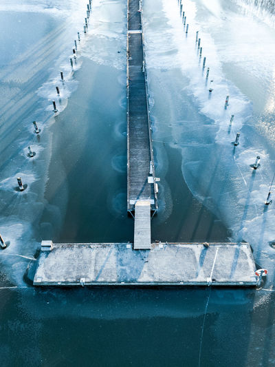 High angle view of pier on sea during winter