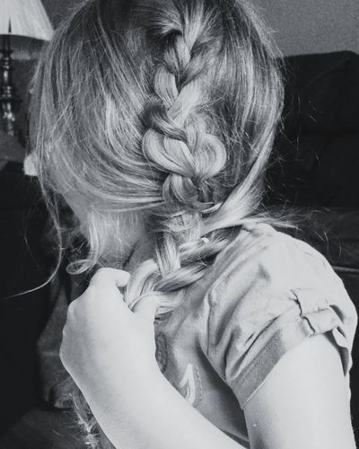 Close-up of girl with braided hair