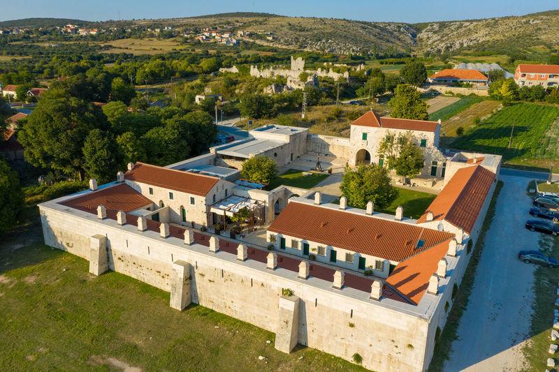 Aerial photo of maskovica han, the ottoman monument in croatia