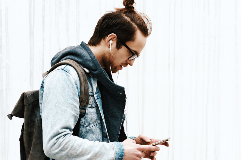 Portrait of man using mobile phone on the street
