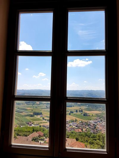 Window Looking Through Window Cityscape Indoors  Sky No People Landscape Day Tree Mountain Architecture City Nature From Top To Valley Aerial View Freshness Cloud - Sky Point Of View Scenics Travel Destinations Piedmont Italy Langhe Castello Di Magliano Alfieri