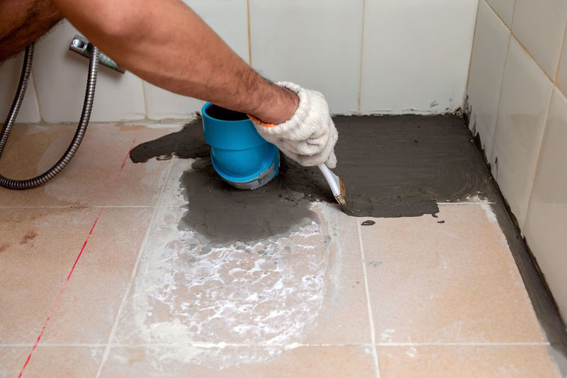 High angle view of person working on floor at home