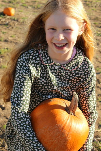 Autumn Dreaming Orange Child Childhood Fun Halloween Happiness Hazeleyes Longhair One Person Outdoors Portrait Pumpkin Pumpkinpatch Pumpkinpicking Real People Redhair Smile Smiling