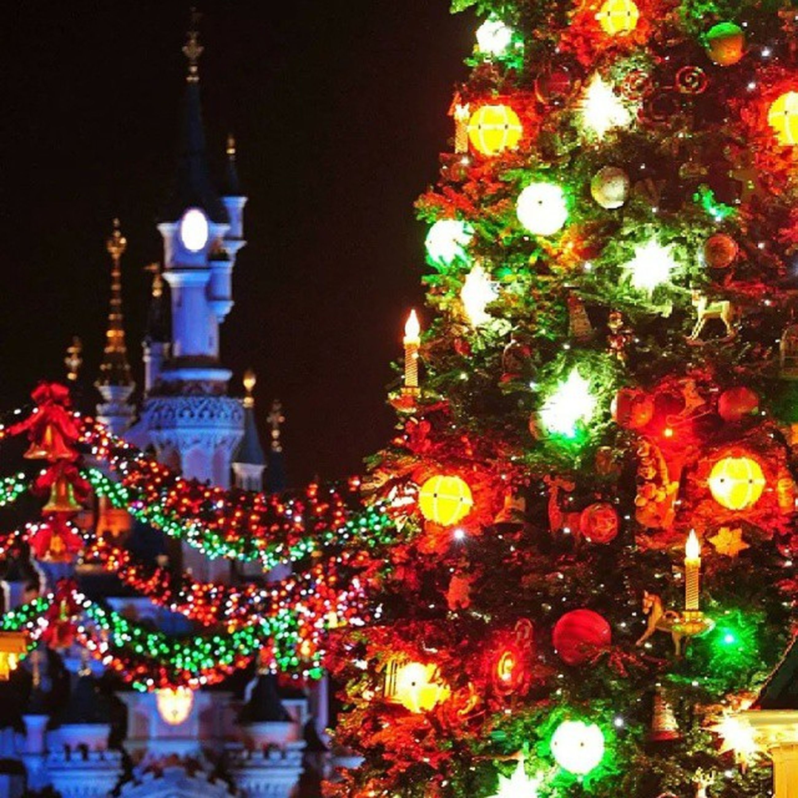 illuminated, night, decoration, celebration, christmas tree, christmas, lighting equipment, christmas decoration, christmas lights, religion, tradition, building exterior, low angle view, architecture, multi colored, built structure, spirituality, cultures, place of worship