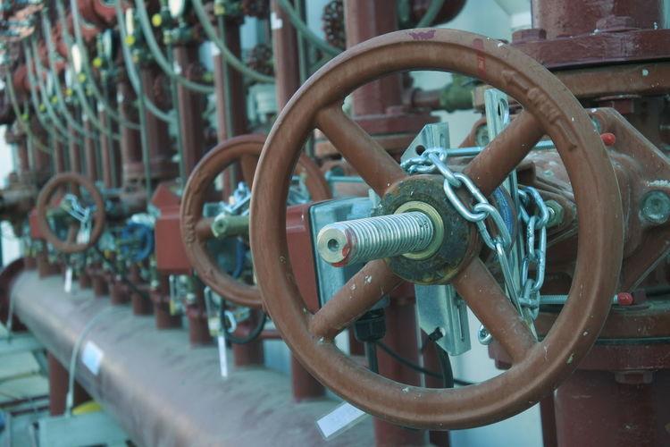 Close-up of rusty machine valve