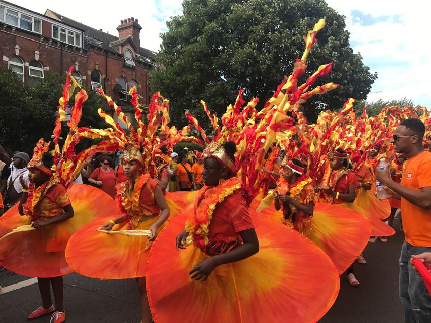 Leeds Carnival 50 Celebration Large Group Of People Real People Cultures Tradition Traditional Festival Spectator Dancing Carnival Men Arts Culture And Entertainment Leisure Activity Traditional Dancing Day Outdoors Togetherness Parade Event Enjoyment Performance Leeds Carnival