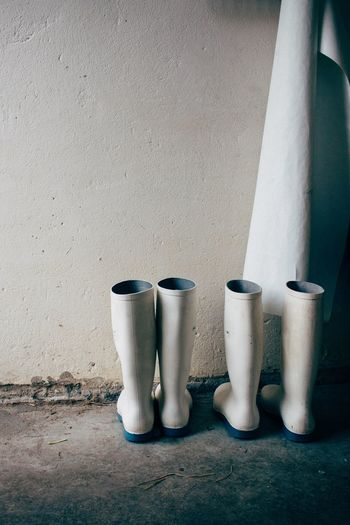 Rubber Boots Against Wall