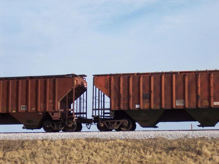 Freight Train Against Sky