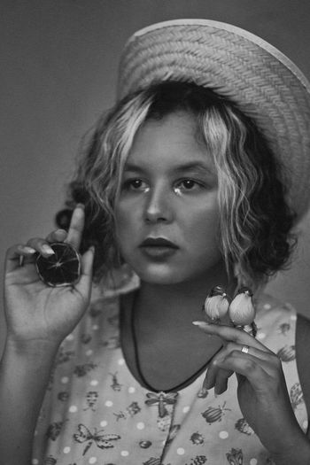 Bird Lady, 2018 Beautiful Woman Beauty Birds Black And White Cigarette  Close-up Clothing Conceptual Photography  Contemplation Front View Hairstyle Hat Headshot Holding Indoors  Leisure Activity Lifestyles Looking At Camera One Person Portrait Real People Straw Hat Women Young Adult Young Women
